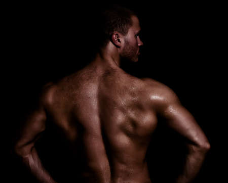 half nude: Rear view of young muscular man Stock Photo