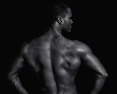 half nude: Rear view of young muscular man. Black and white