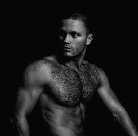 half nude: Portrait of a handsome naked muscular guy. Black and white Stock Photo