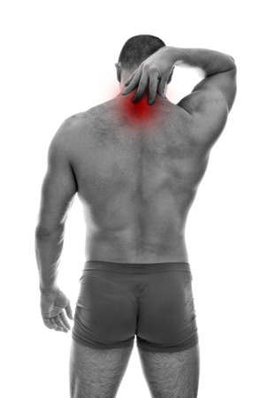 Rear view of muscular man with neck pain. Isolated on white. black and white photo