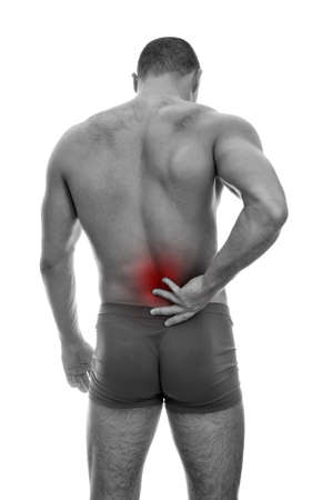 Rear view of muscular man with spinal pain. Isolated on white. black and white Stock Photo - 15440112