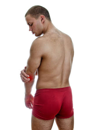 Rear view of muscular man with elbow pain  Isolated on white Stock Photo - 15440157