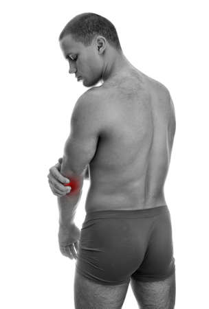 Rear view of muscular man with elbow pain  Isolated on white  black and white photo