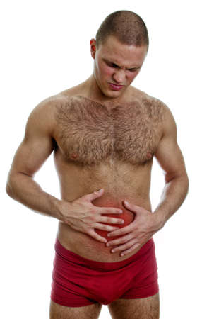 Front view of muscular man suffering from stomach pain  Isolated on white   Stock Photo - 15440252