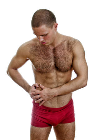 Front view of muscular man suffering from stomach pain  Isolated on white   Stock Photo - 15440143