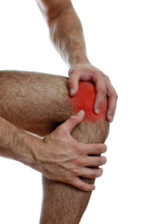 Close up view of male hands holding his sore knee  Isolated on white Stock Photo - 15440174