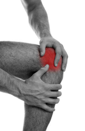 Close up view of male hands holding his sore knee  Isolated on white  black and white Stock Photo - 15440165