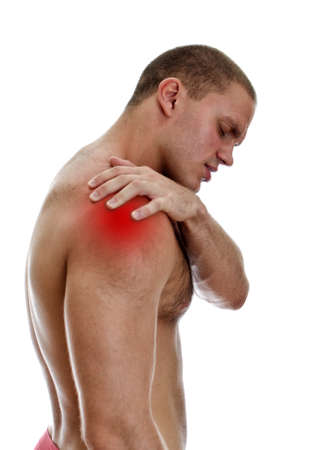 Young man suffering from pain in his shoulder  Isolated on white Stock Photo - 15440142