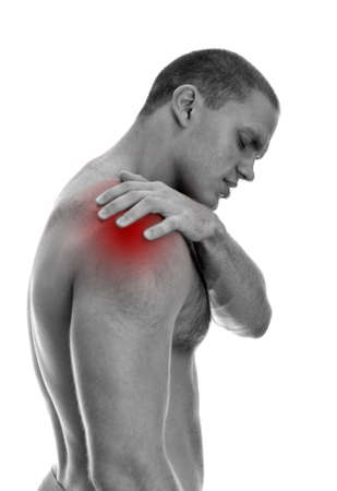 Young man suffering from pain in his shoulder  Isolated on white  black and white Stock Photo - 15440139