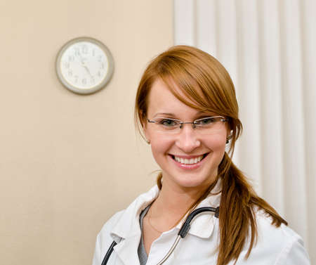 Portrait of young female doctor in office Stock Photo - 15689139