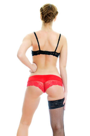 Rear view of young woman in sexual lingerie Isolated on white Stock Photo - 16221744