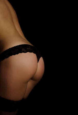 Close up view of slim female buttock  Black background Stock Photo - 16221738