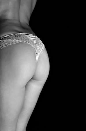 half nude: Close up view of slim female buttock  Black and white Stock Photo