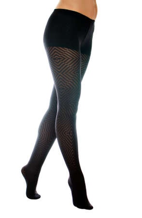 Sexy female legs in black tights on the toe  Isolated on white Stock Photo - 16194087
