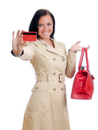 Smiling woman with red credit card and bag. Isolated on white. photo