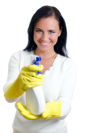 disinfect: Happy housewife with window cleaner. Isolated on white.