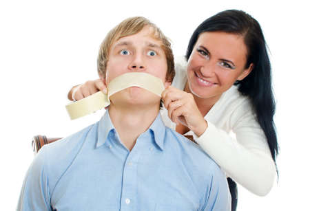 Woman applying tape on man photo