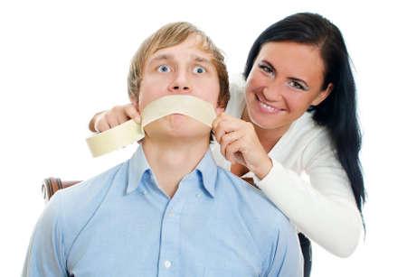 silenced: Woman applying tape on man