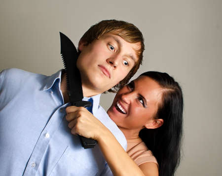 Woman is trying to kill man by knife  photo