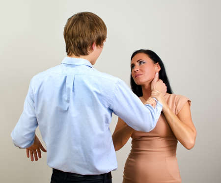 Man slapping a woman depicting domestic violence  photo