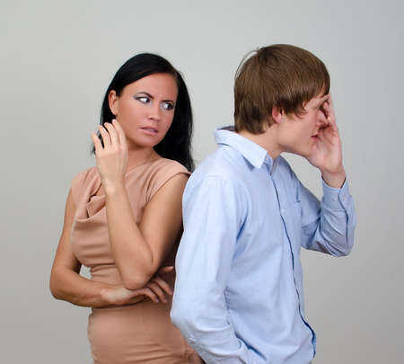 Young couple quarreling  Standing back to back photo