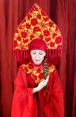 kokoshnik: Woman in russian traditional clothes welcomes you