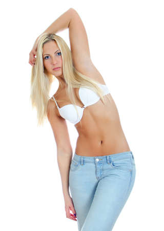 half nude: Pretty blonde girl wearing jeans and bra. Isolated on white