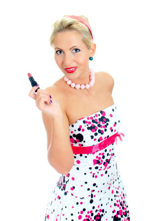 Pin-up retrato de mujer con l�piz labial aislado en blanco photo