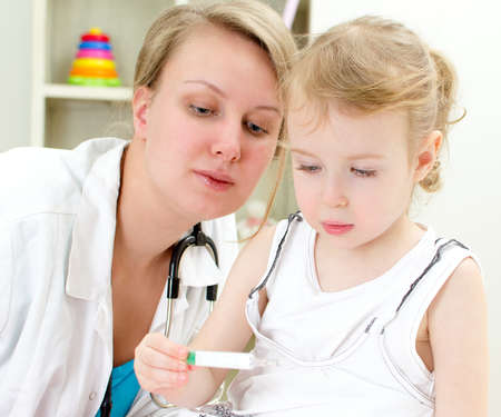 Cute little girl visiting pediatrician photo