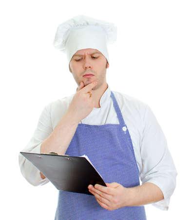 Thinking chef composing new menu. Isolated on white photo