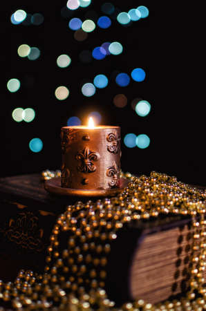 frippery: Burning candle and seasonal decorations on bokeh lights background