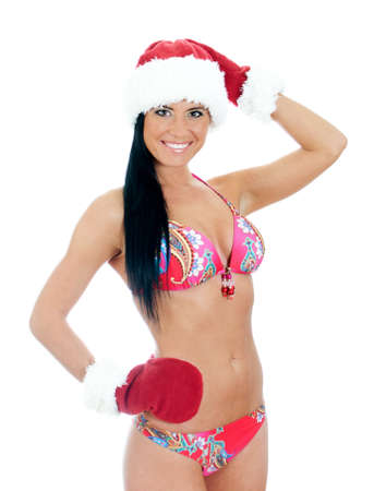 Young sexy woman wearing bikini and christmas hat and gloves . Isolated on white photo