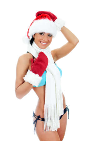 Young sexy woman wearing bikini and christmas hat and gloves . Isolated on white Stock Photo - 17038599