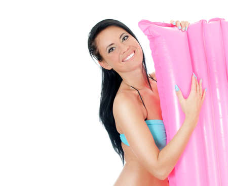 Pretty young woman holding pink inflatable mattress. Isolated on white Stock Photo - 17038568