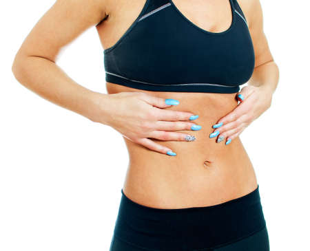 Woman suffering from stomach ache. Isolated on white. Stock Photo - 17038622