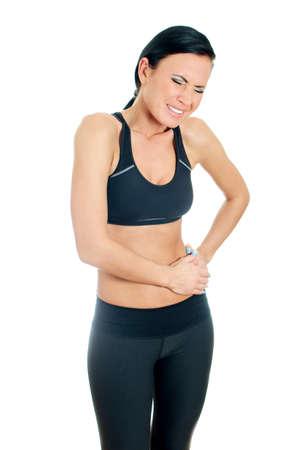 masaje deportivo: Mujer que sufre de dolor en el costado izquierdo. Aislados en blanco