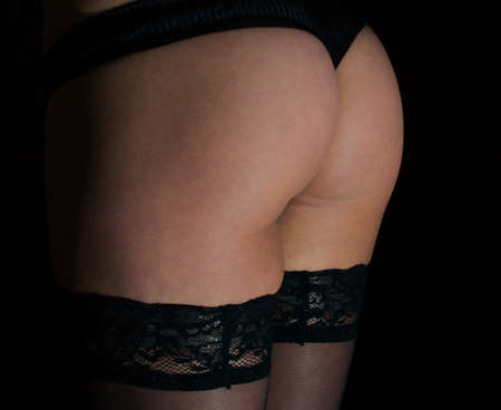 Sexual female buttocks in black panties  photo