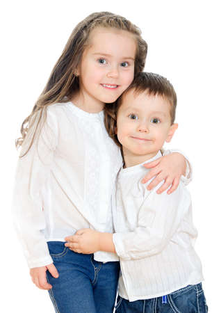 Little girl and boy hugging  Isolated on white photo
