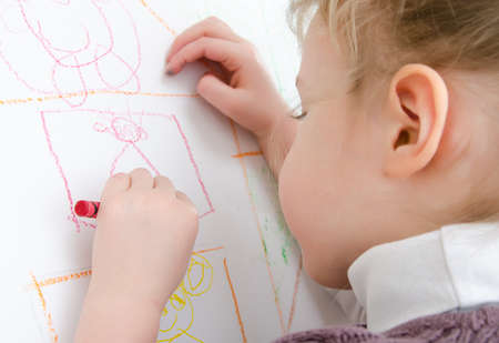 left handed: Cute little girl drawing with pencil