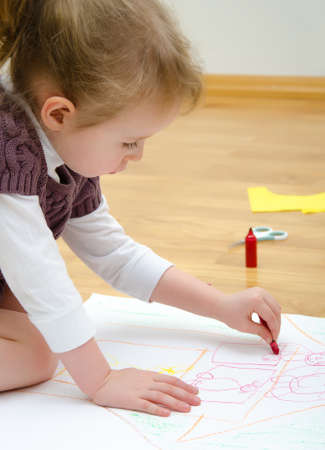 art therapy: Cute little girl drawing with pencil