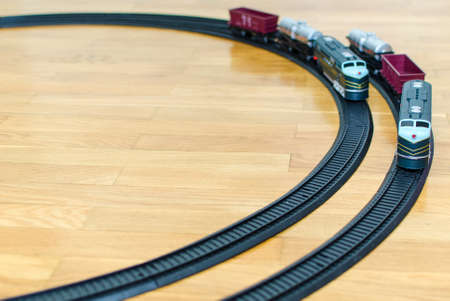 Two toy trains on wooden floor photo
