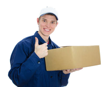Young smiling courier holding cardboard box. Isolated on white photo