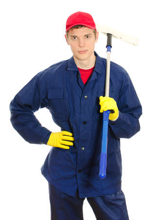 houseman: Young male window cleaner with wiper. Isolated on white Stock Photo