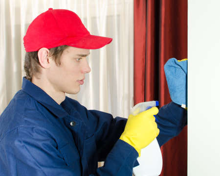 houseman: Young male cleaner with tools. Isolated on white