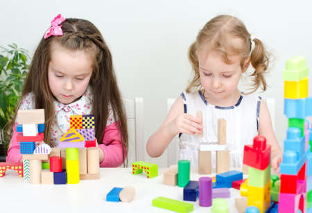 color therapy: Two little girl playing with building blocks Stock Photo