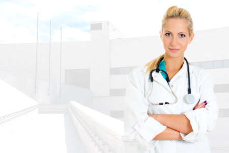 Young pretty female doctor in uniform over hospital background photo