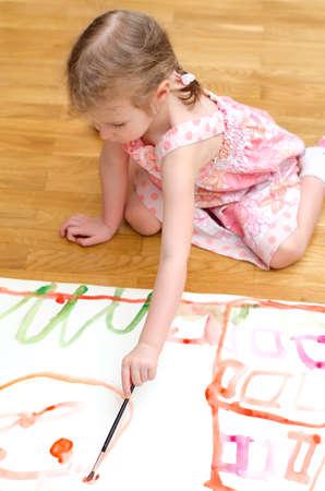 pretty little girl: Pretty little girl painting sitting on the floor