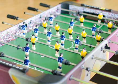 Table football game with yellow and blue players photo