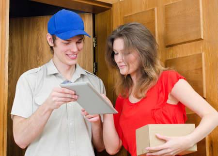 Young courier deliver package to pretty woman Stock Photo - 19225377