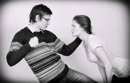 unprotected: Man going to beat his wife. Home violence concept. Black and white